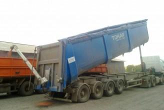 Тонар-95234 Самосвальный полуприцеп с лючками и желобом для перевозки зерна
